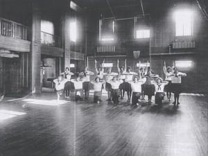 Photo of students at desks, taken around 1920