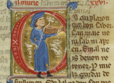 Decorated initial with a man playing a fiddle