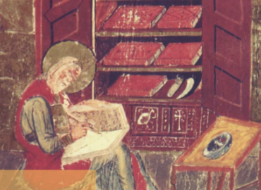 Medieval man at desk